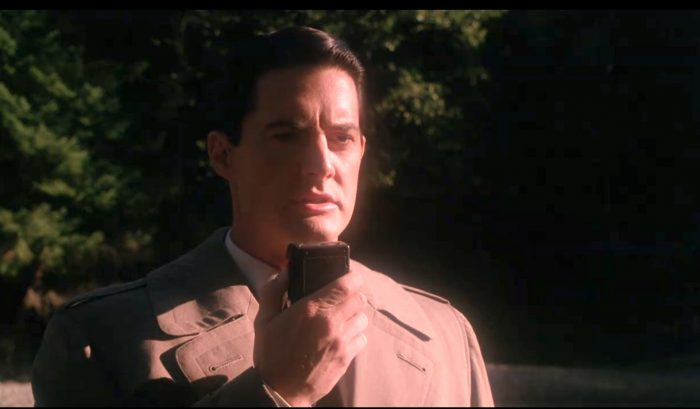 Dale Cooper speaking into his tape recorder in Twin Peaks