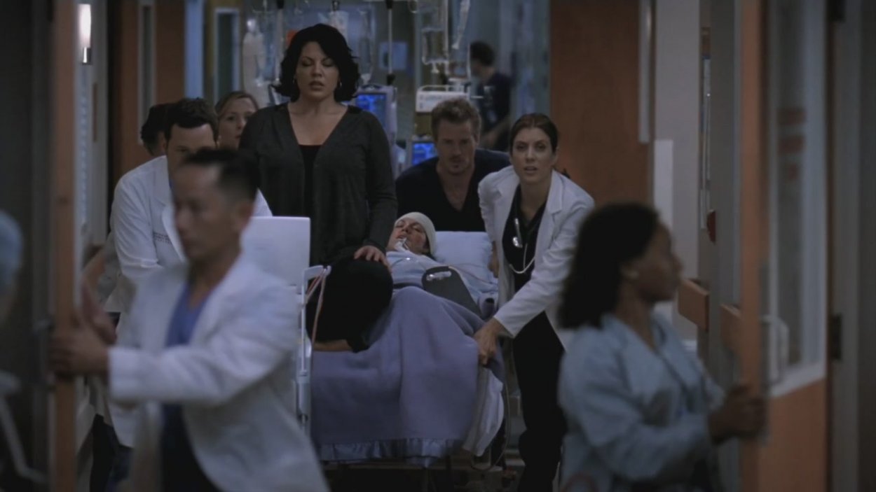 "Callie's ""spirit"" sits on top of her body as she is rushed by the doctors to the O.R."