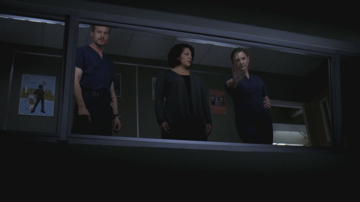 Callie's spirit stands in the observation room with a worried Mark and Arizona.