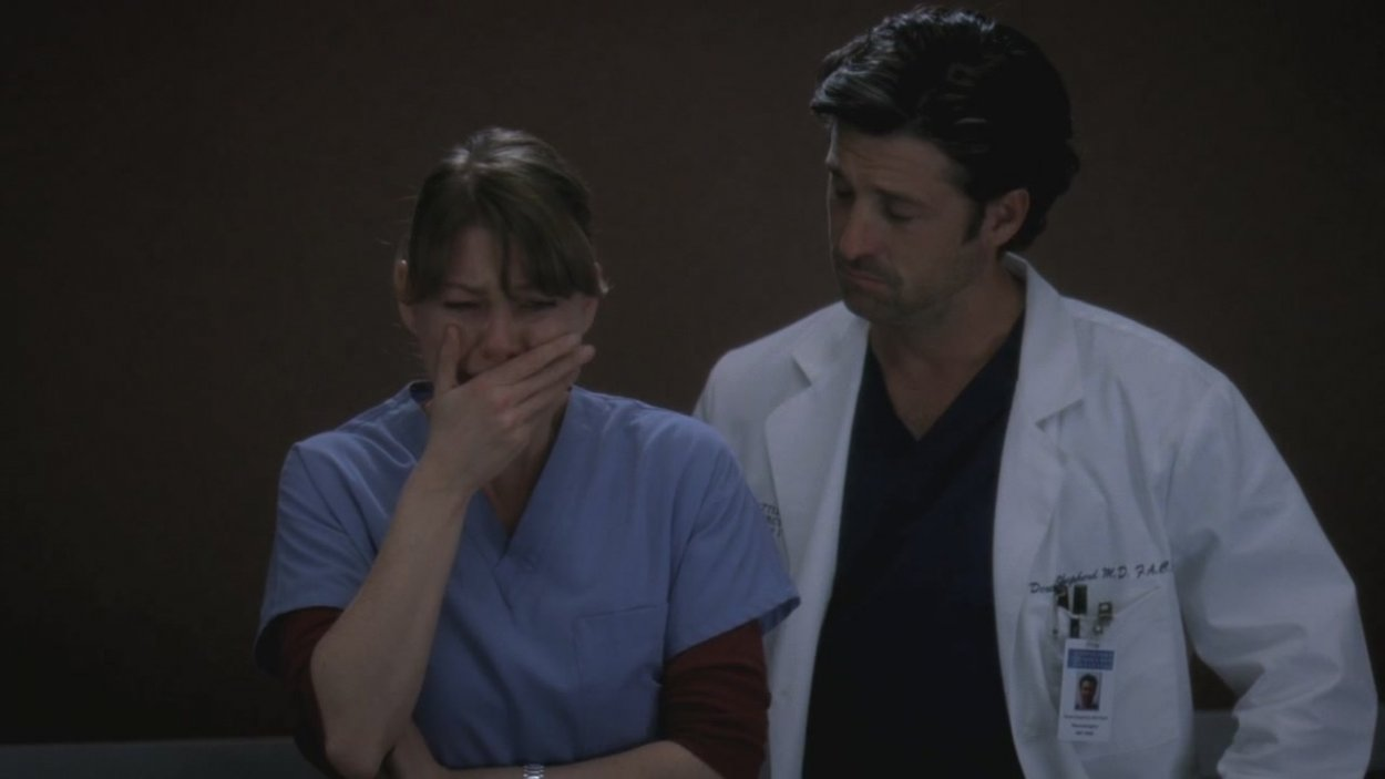 Meredith breaks down in an elevator while Derek comforts her.