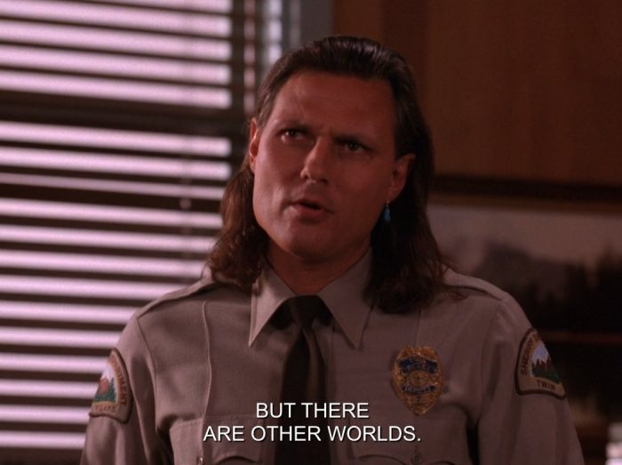 Hawk schooling Cooper on other worlds within the universe.