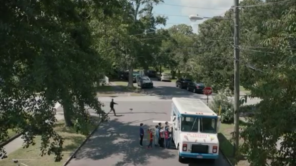 Mr Mercedes - An ice cream truck is parked on a street, a crowd of kids at the window