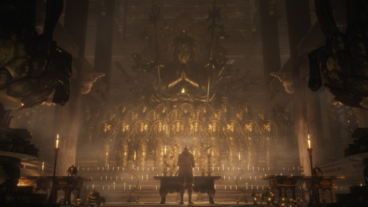 Sekiro stands in a large, golden temple praying at an altar.