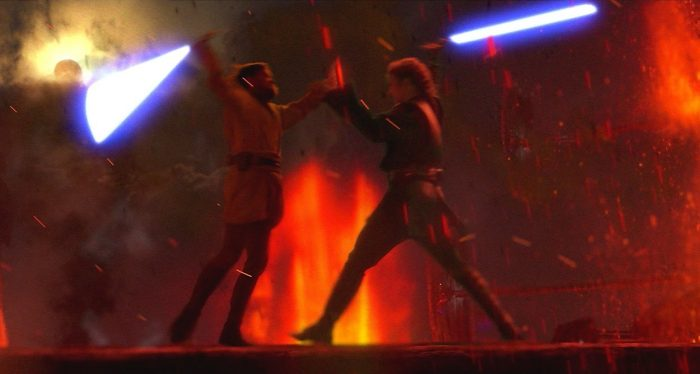 Anakin and Obi-Wan battle for their lives using lightsabers on the firey planet Mustafar