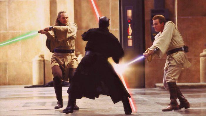 Qui-Gon Jinn and Obi-Wan Kenobi battle it out with Darl Maul using lightsabers on Naboo
