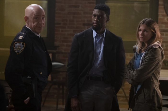 Captain McKenna, Andre, and Frankie speak at a crime scene