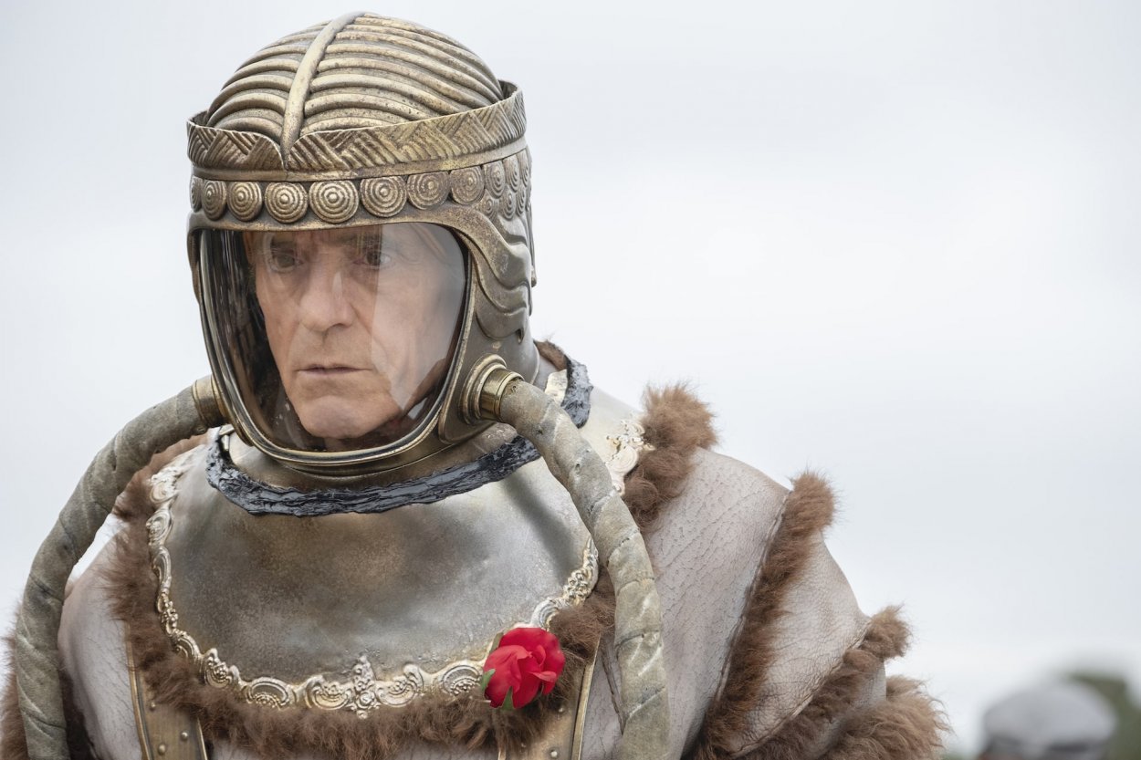 Veidt in his space suit with a red rose