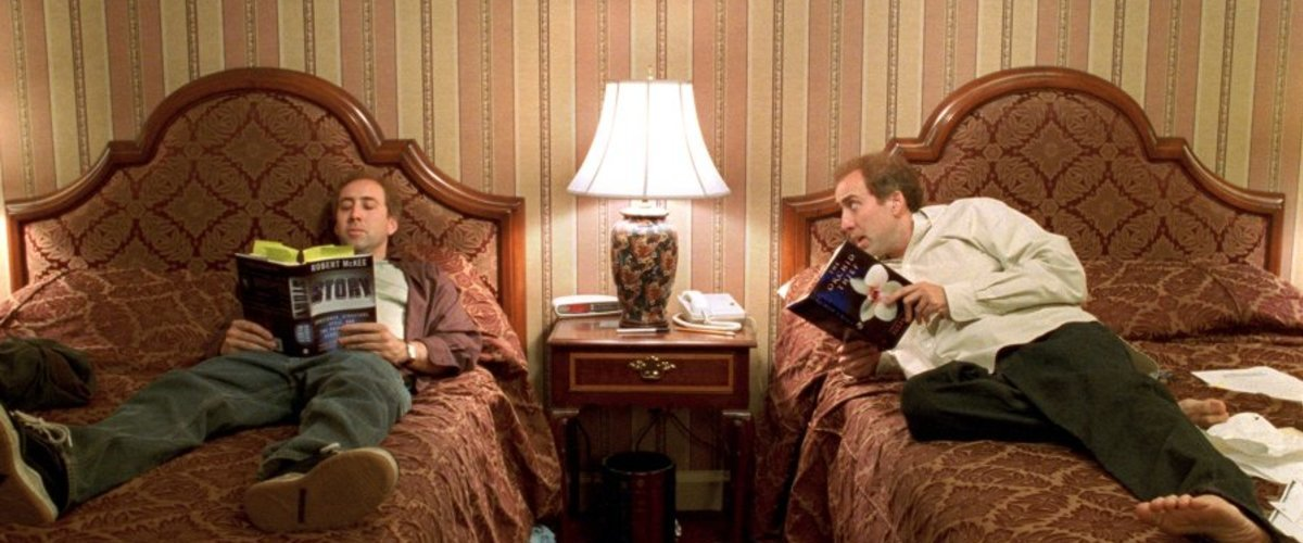 Charlie and Donald Kaufman in a hotel room