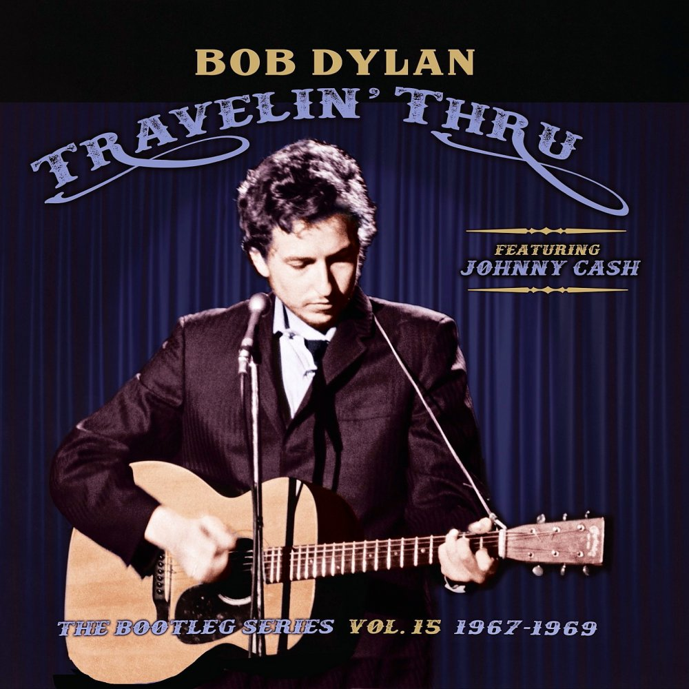 Bob Dylan strums a guitar on the cover of Travelin' Thru