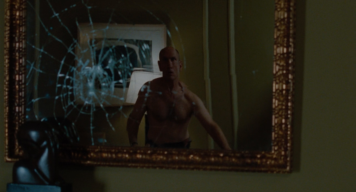 John Malkovich controlled by Craig dances and smashes his mirror