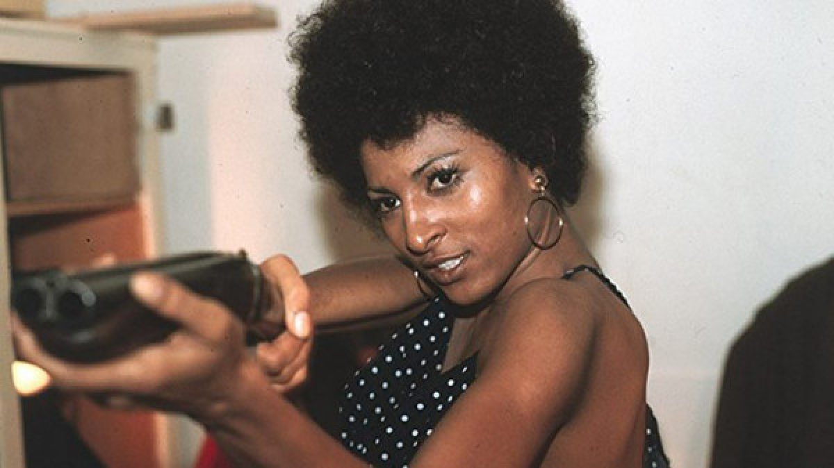 Coffy (Pan Grier) Is Levelling A Sawed Off Shotgun At An Unknown Assailant.
