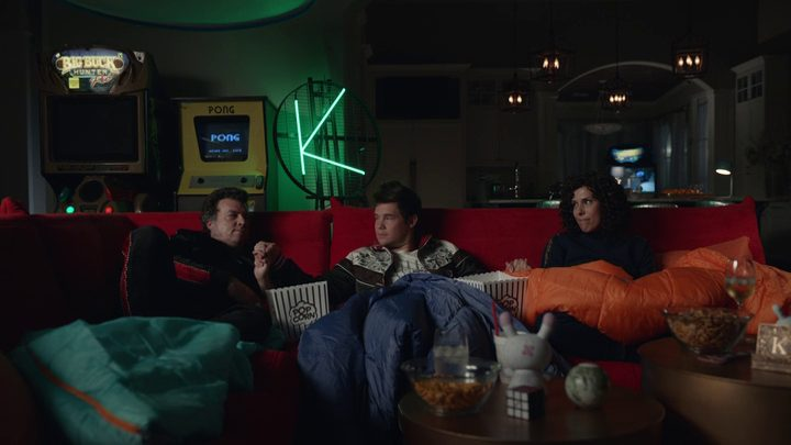 Jesse (Danny McBride), Kelvin (Adam Devine) and Judy (Edi Patterson) sit together on a couch at Kelvin's house