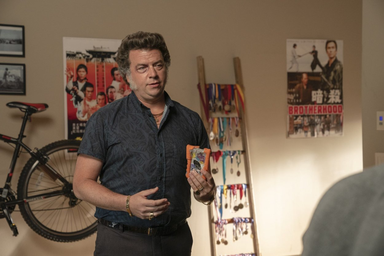 Jesse (Danny McBride) stands in his son Gideon's room holding the blackmail tape.