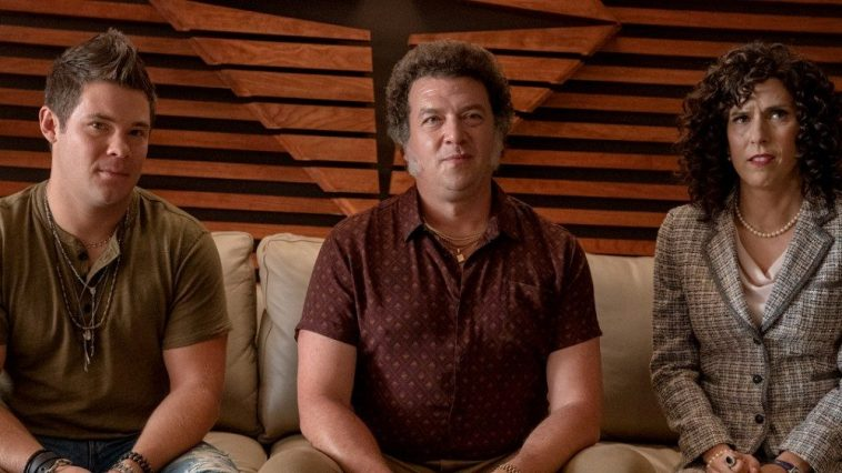 Kelvin (Adam Devine), Jesse (Danny McBride) and Judy (Edi Patterson) sit on a couch in their father's office.