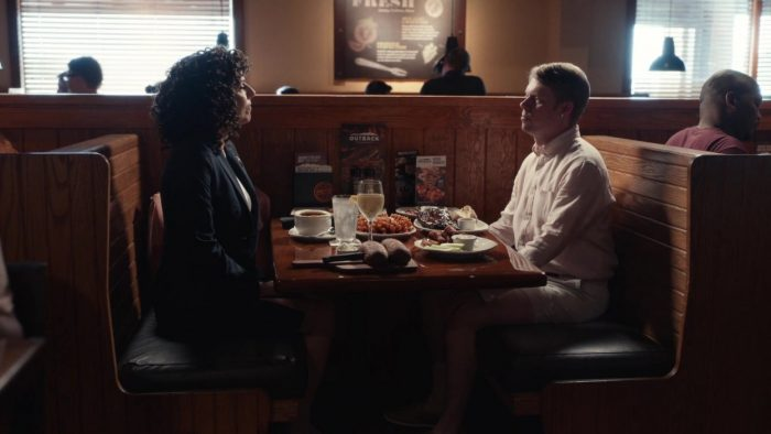 Judy (Edi Patterson) and BJ (Tim Baltz) discuss their relationship in an Outback Steakhouse