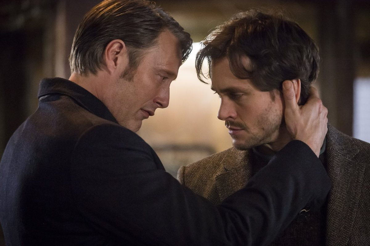 Dr Lecter holds the back of Will's head, their foreheads almost touching, in an intimate moment