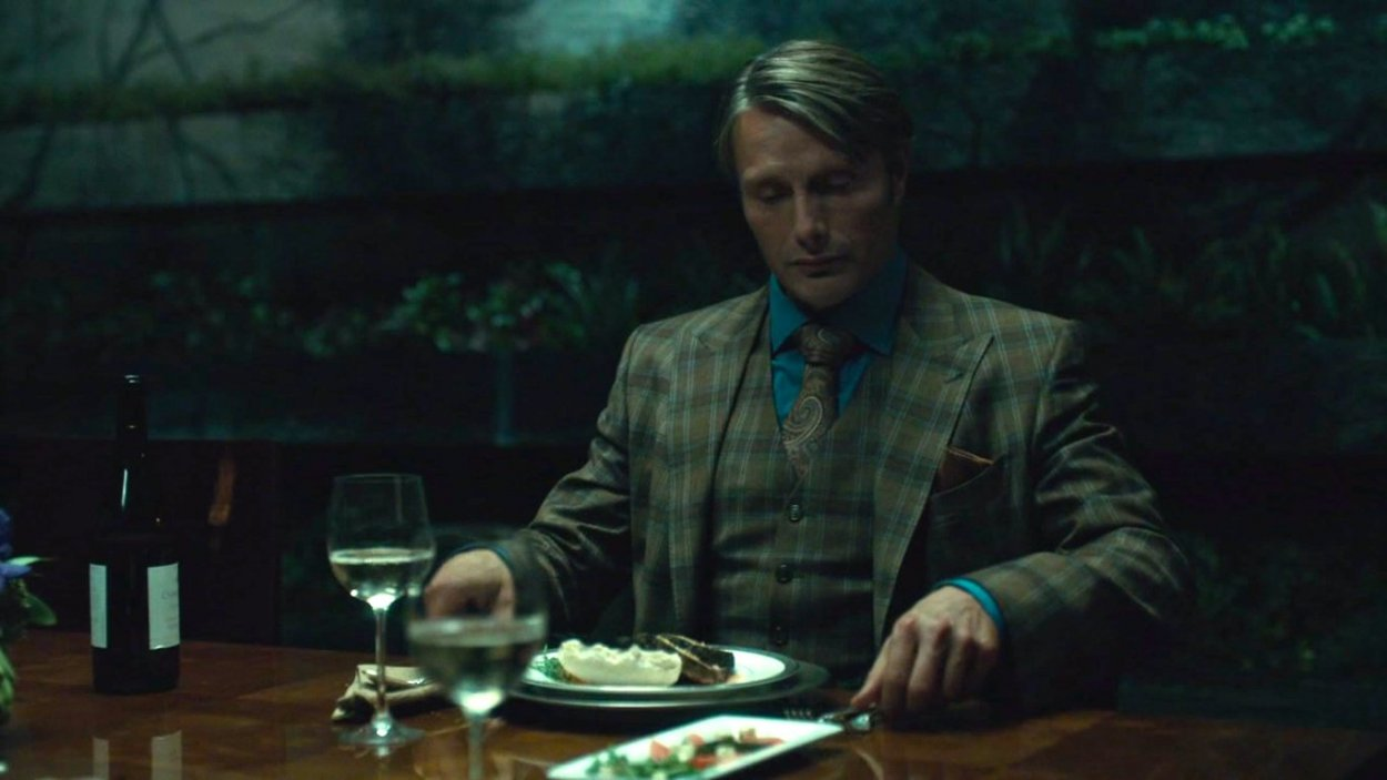 Dr. Lecter at his dinner table, apparently alone