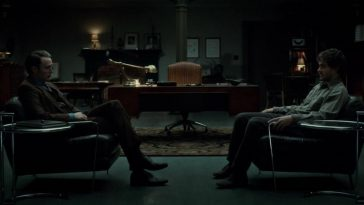 Will and Hannibal sit in chairs opposite each other in Dr. Lecter's office