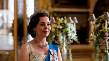 The Queen wears her regal tiara and smiles