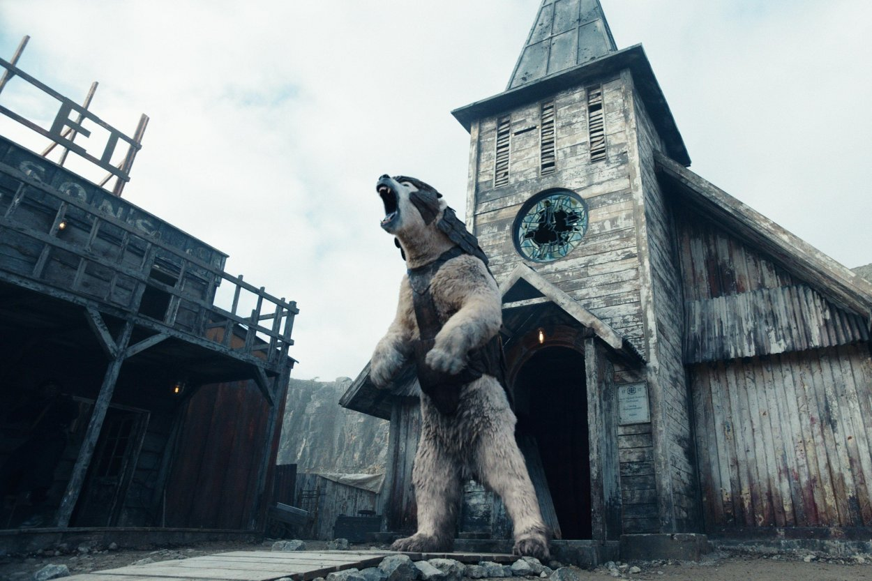 A giant polar bear wearing armour, stands up on his hind legs in front of a church, and roars