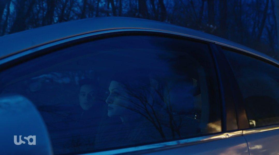 Elliot and Darlene sit in a car