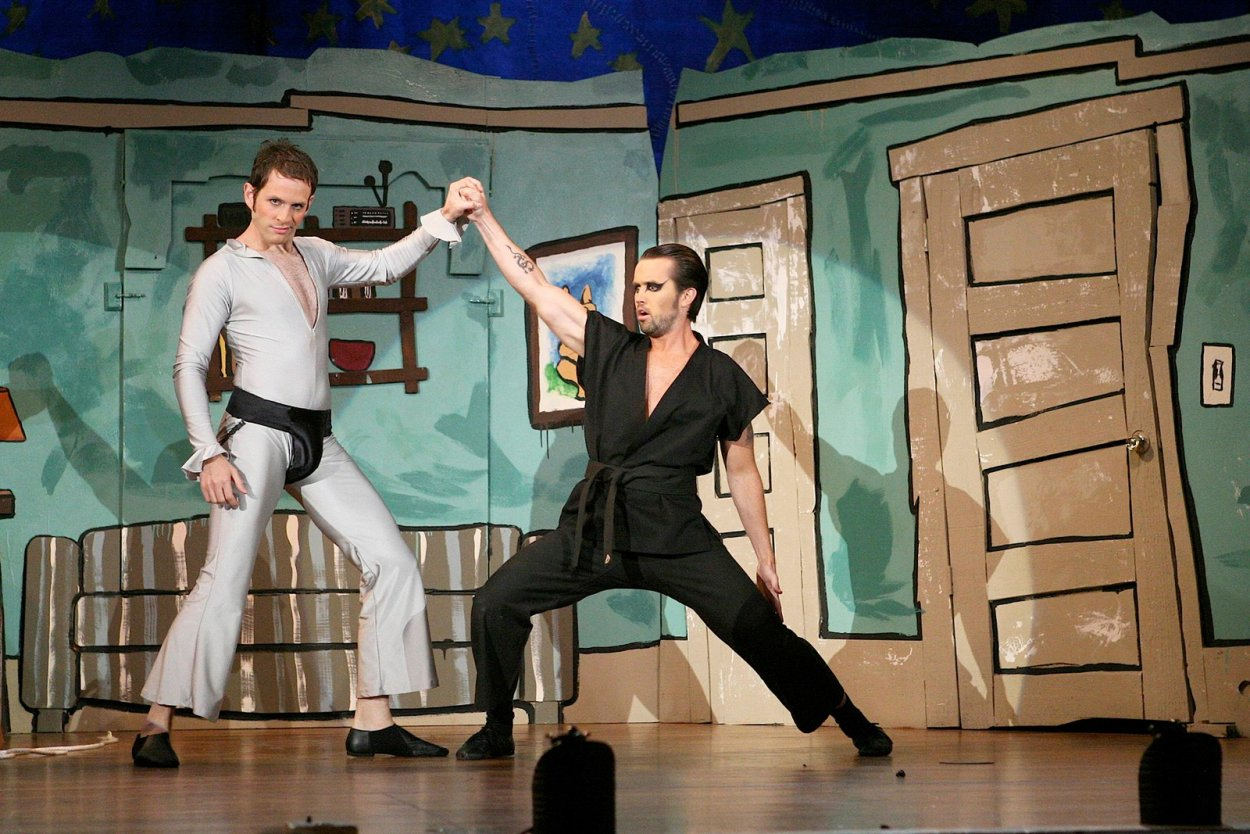 Dennis (The Dayman) fights Mac (The Nightman) on stage