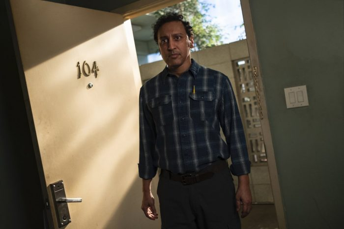 Dr. Eugene Hill stands in the doorway of Room 104