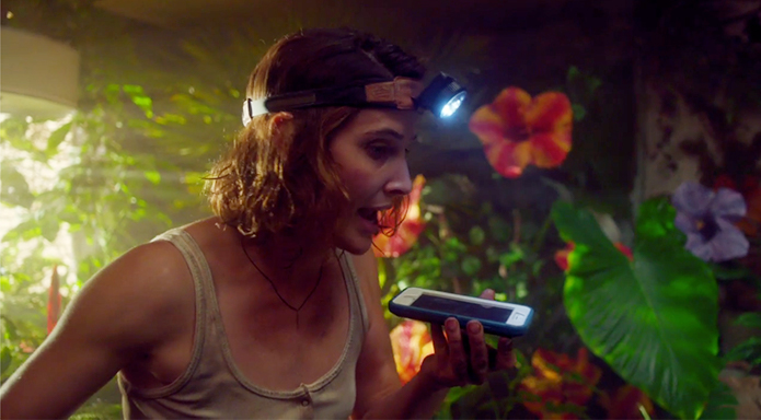 Marianne wearing a headlamp, talking to Joe on her phone