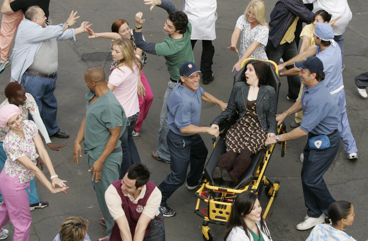 Turk, J.D. and Ms. Miller are all doing the initial dance number of the episode
