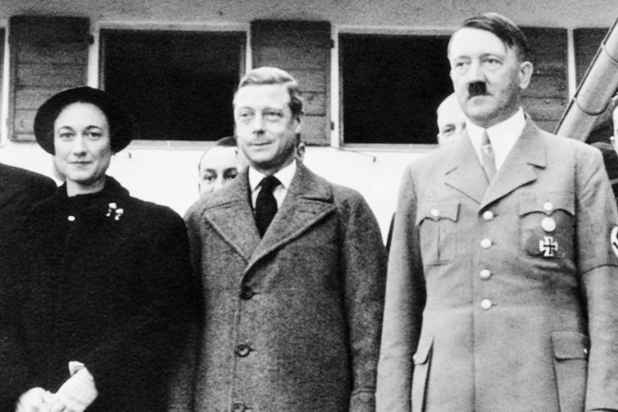 A black and white photo of Wallis Simpson and Edward VIII meeting Hitler