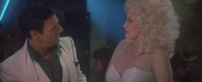 Freddie and Jake stare at each other as they make a bet in Rhinestone