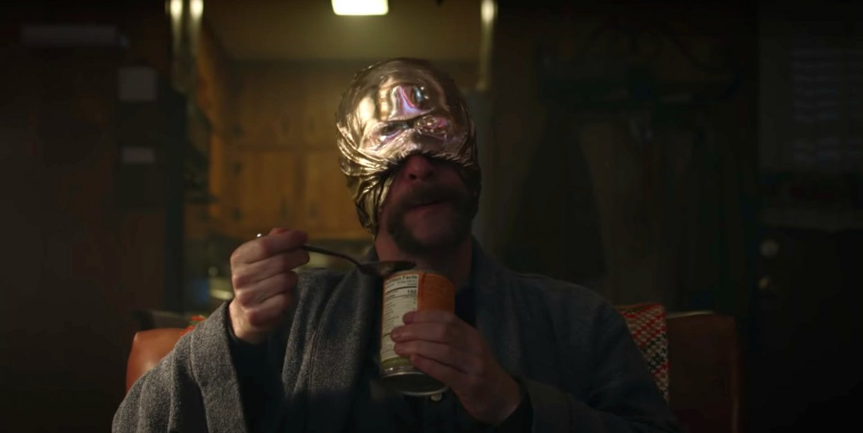 Looking Glass eats from a can in HBO's Watchmen