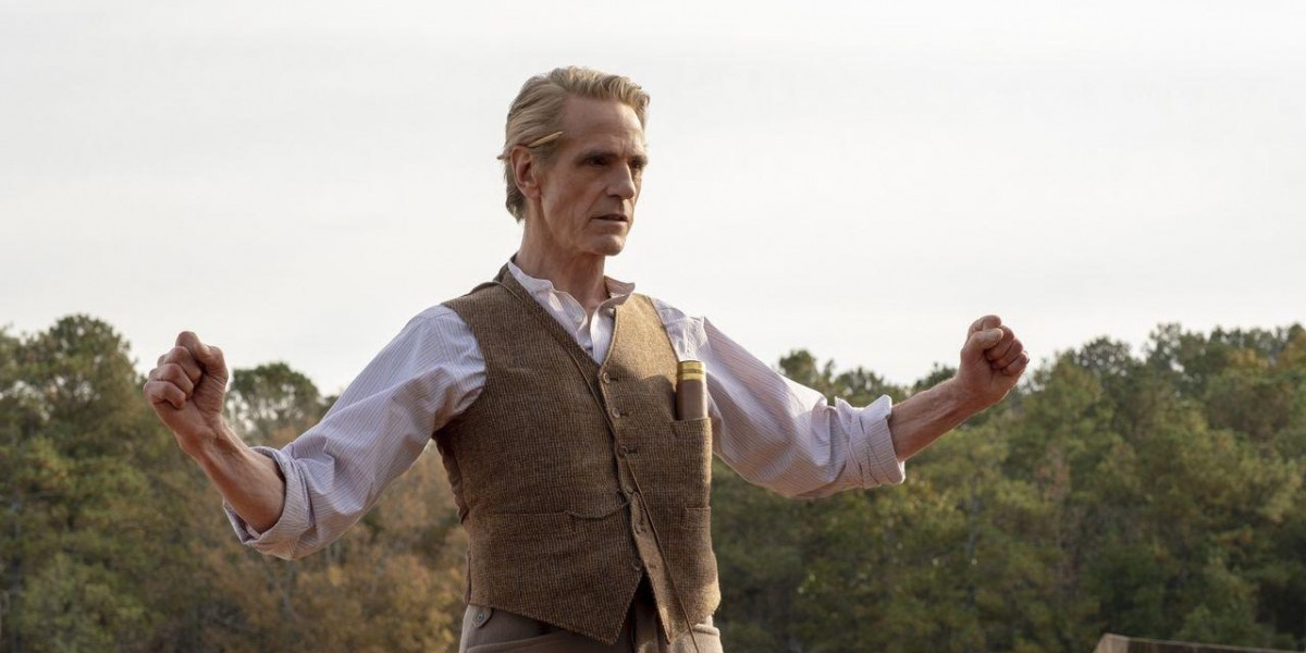 Adrien Veidt (Jeremy Irons) holds his arms out next to his catapult