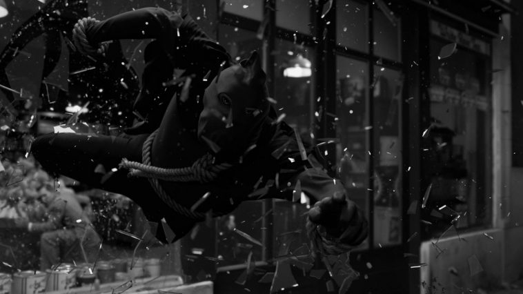 Hooded Justice dives through the front window of a grocery store.