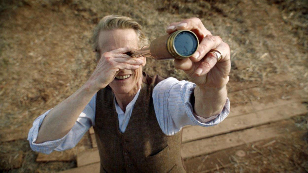 Adrien Veidt (Jeremy Irons) gazes skyward through his spyglass.