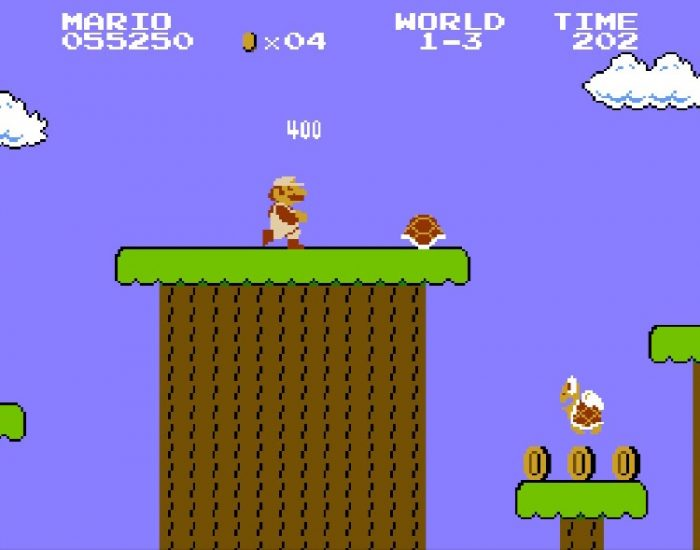 Mario kicks a turtle shell off a ledge attempting to take out the flying Koopa Trooper.