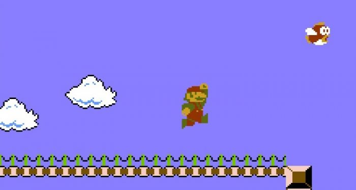 Super Mario navigates a bridge where red fish (Cheep Cheeps) shoot out of the water.