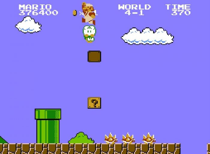 Super Mario jumps on top of Lakitu, a hooded little green guy in a cloud that drops red Spiney enemies down on you.