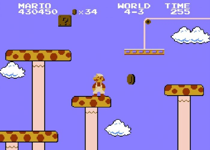 Super Mario stands on giant yellow and red-spotted mushrooms that act as platforms.