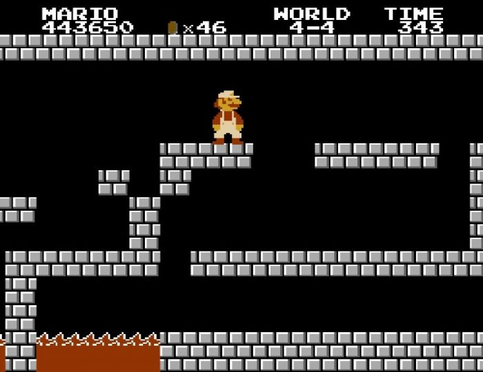 World 4-4. Pictured, Super Mario is inside the standard level ending castle location featuring gray bricks and lava pits.