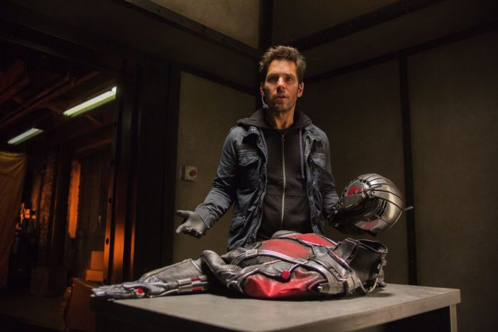 Scott Land stands in a room with the Ant-Man costume, confused