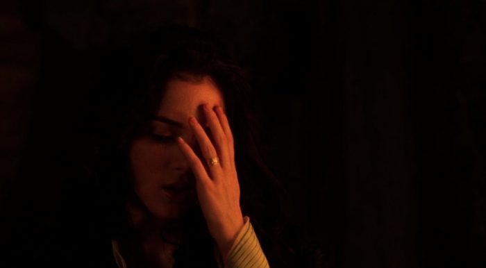 Mina Harker (Winona Ryder) touches her forehead, feeling where a scar once was in Bram Stoker's Dracula.