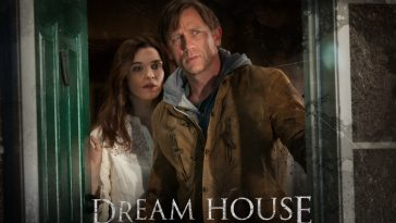 Daniel Craig and Rachel Weisz as Will and Libby in Dream House standing in center of window looking at something in front of them with trepidation