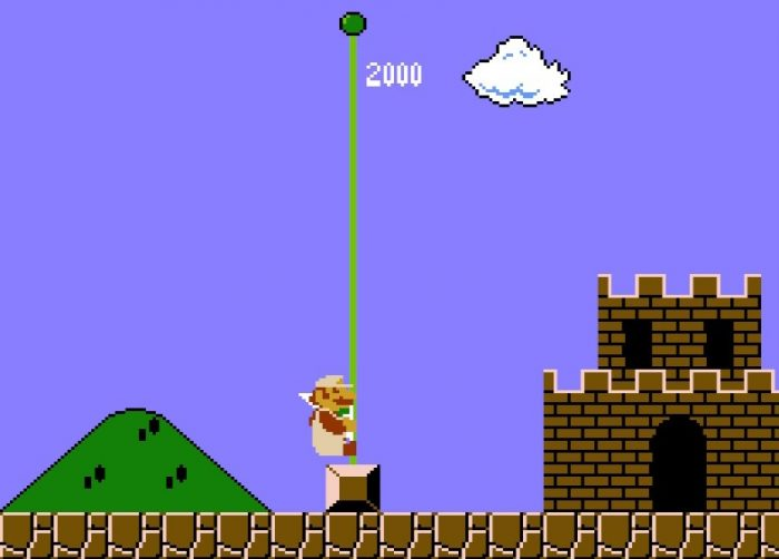 Mario slides down the flagpole at the end of the level, gaining 2000 points.