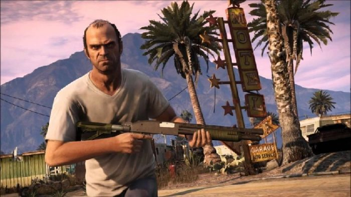 Trevor Phillips, a demented lunatic, and one of your three playable characters is shown here rampaging through a motel parking lot. The balding man, in a white t shirt, is brandishing a shotgun and an angry look on his face.