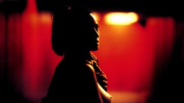 Monica Belluci as Alex turning around as she walks down a red lit underpass in Irreversible