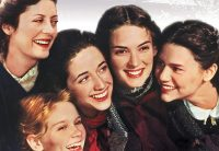 The March women laugh together in Little Women, including Mrs. March (Susan Sarandon), Amy (Kirsten Dunst), Meg (Trini Alvarado), Jo (Winona Ryder), and Beth (Claire Danes)
