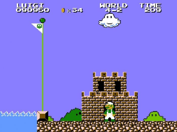 Luigi stands in the doorway of the mini castle, looking back at the end level flagpole he just jumped over.