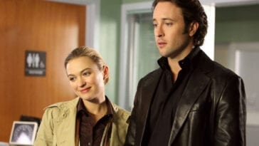 Mick and Beth stand in a hospital room