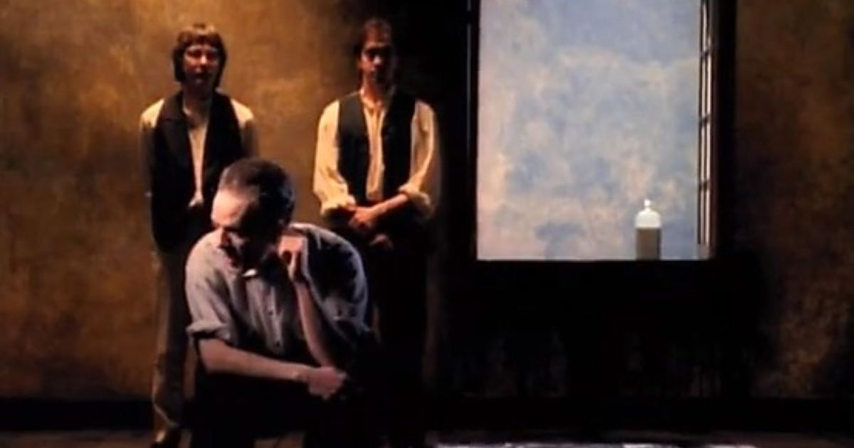 A still from the video of Losing My Religion. The band by a window.